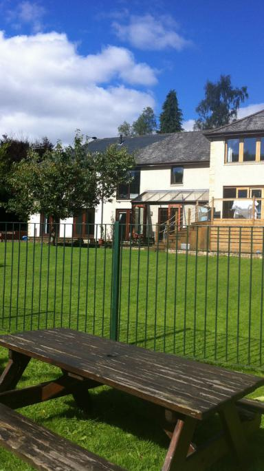 Relax in the riverbank garden at Riverside B&B, Callander