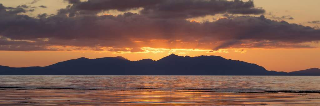 View of the sunset from Ayr beach looking over Isle of Arran
