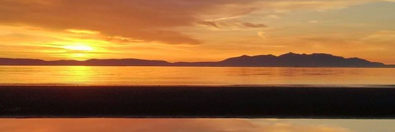The sun going down on the Ayrshire coast with Isle of Arran in the distance