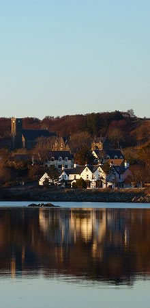 View from across the loch of The Arisaig Hotel